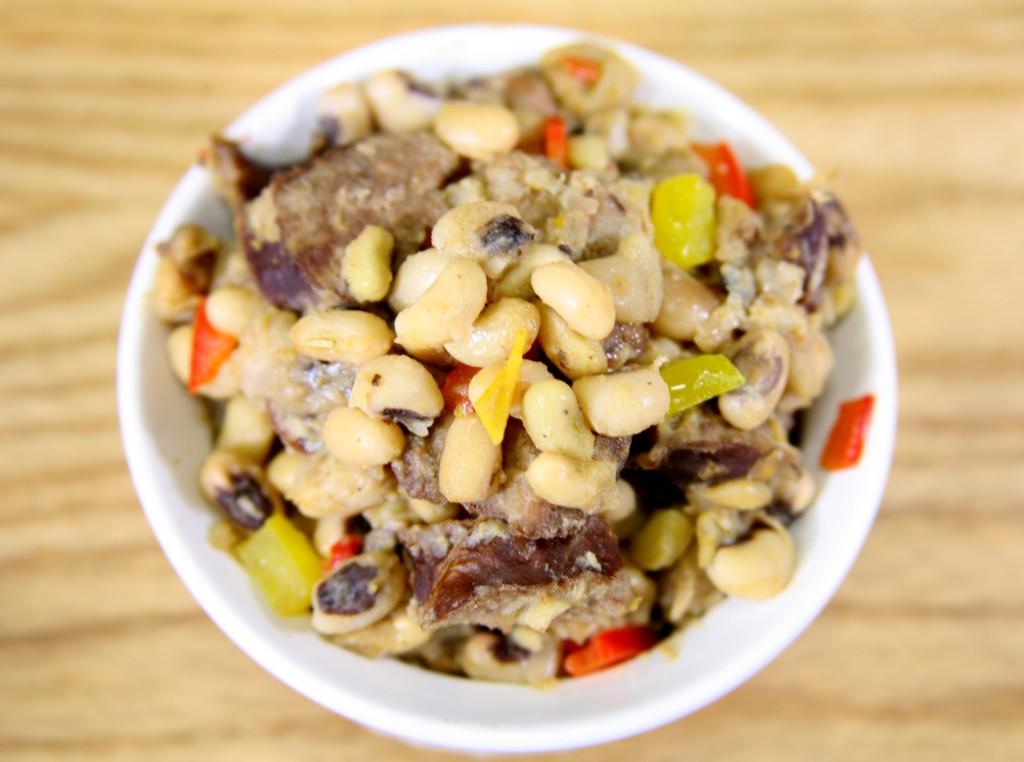 Bone Suckin'® Spicy Peas and Sausage Recipe