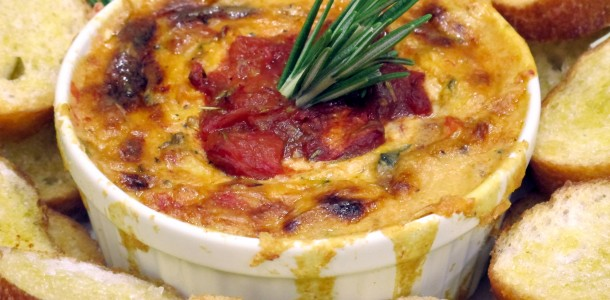 Our Bone Suckin' Roasted Tomato & Brie Cheese Dip Recipe is so yummy, you will want to dip more than chips in it.